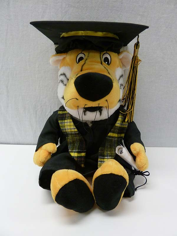stuffed Truman in graduation cap and gown