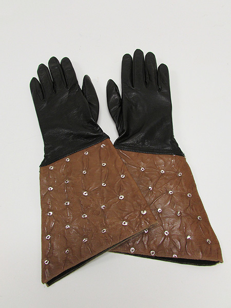 Cow and Ostrich Skin Gauntlet Style Gloves with Metal Grommets (1900s-10s) Missouri Historic Costume and Textile Collection, University of Missouri